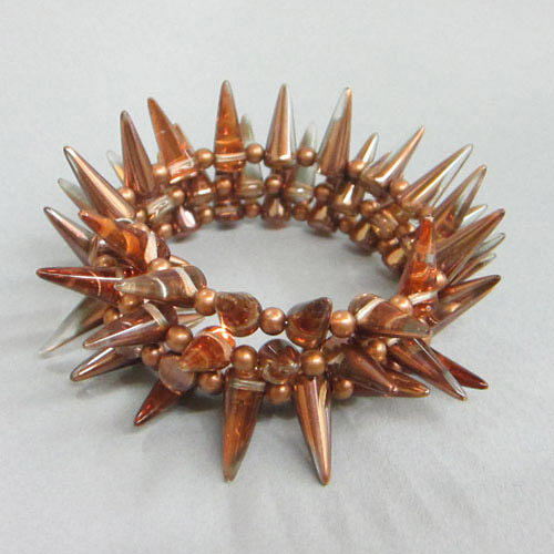 Spike bracelet with memory wire