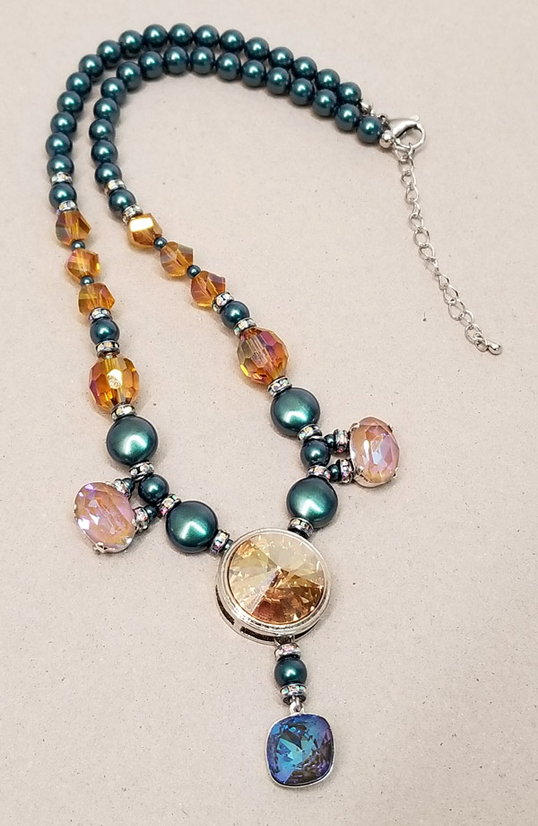 Festive necklace with Swarovski crystal iridescent Tahitian look pearl